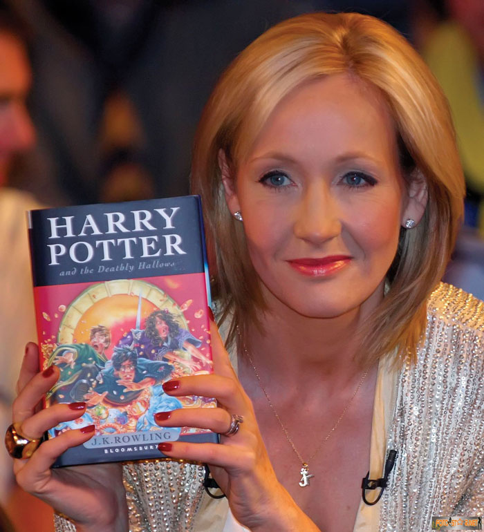 j-k-rowling holding harry potter book